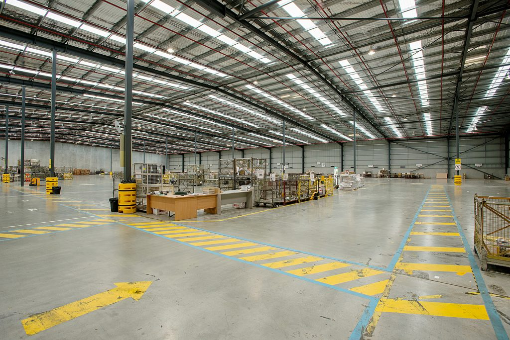 Australia Post Derrimut inside warehouse with yellow markings on floor