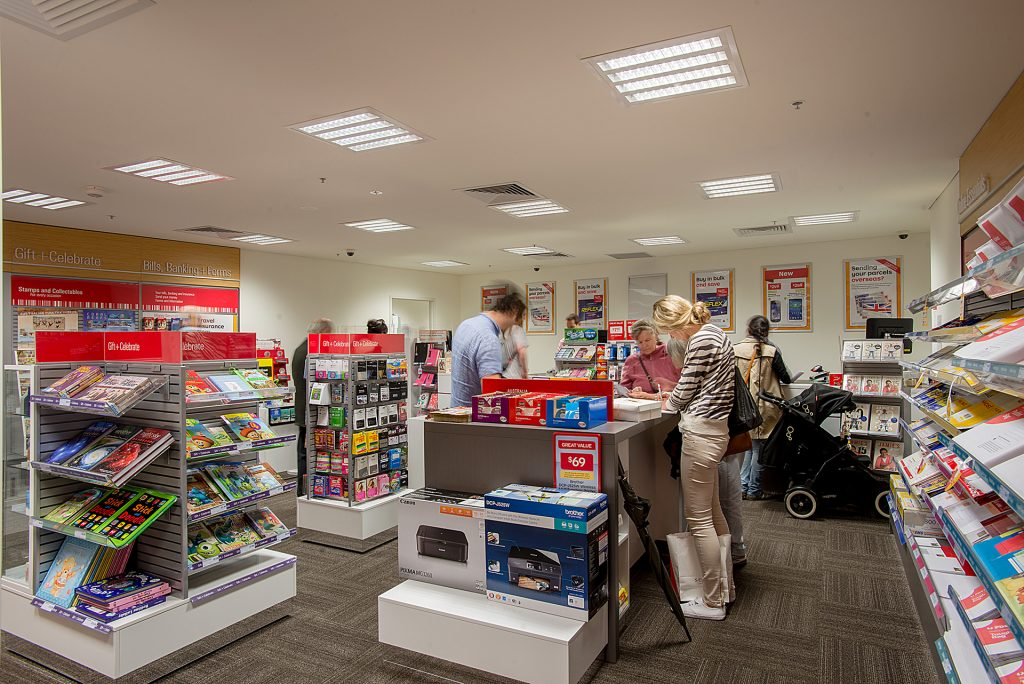 Customers shopping in the new post office fit-out