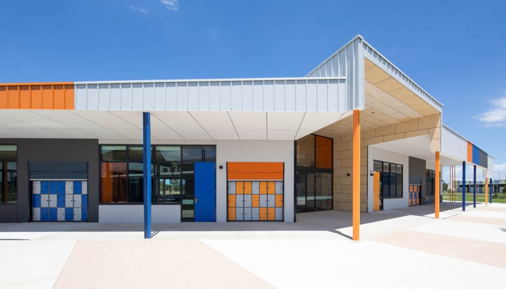 Alfresco area of learning centre with orange and blue support columns