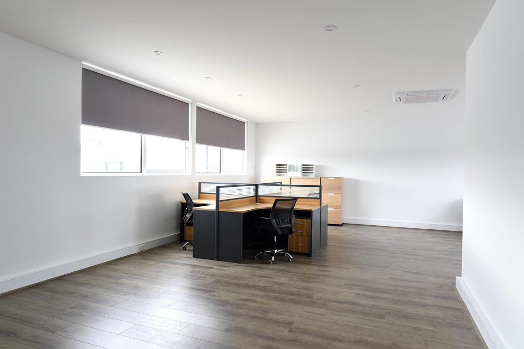 Office space with desk close to window