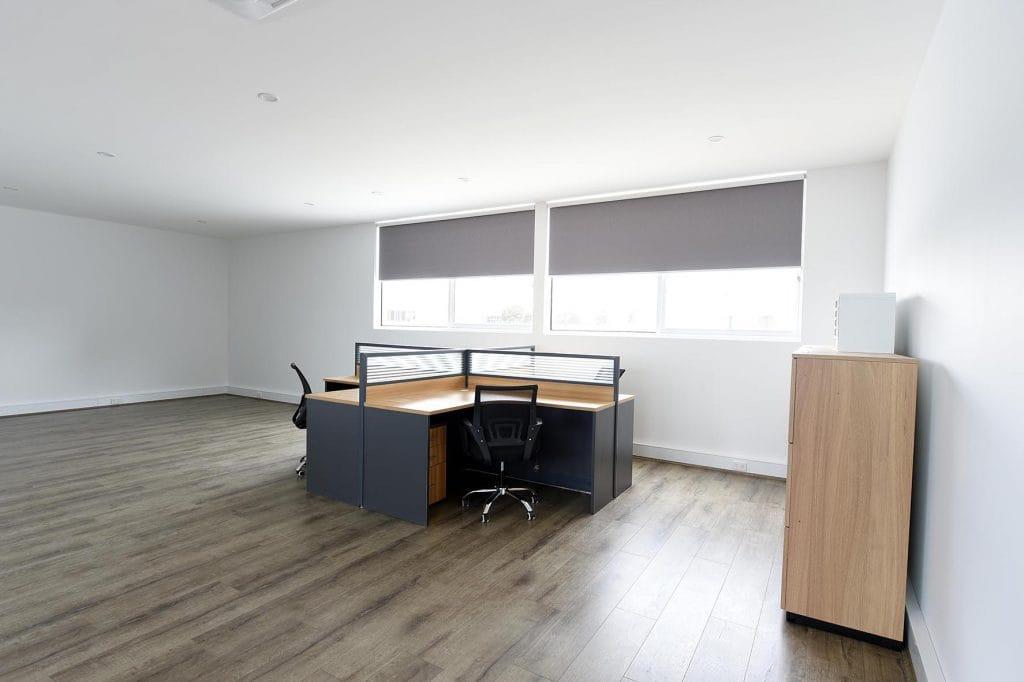 Office desk set up in hardwood floor room