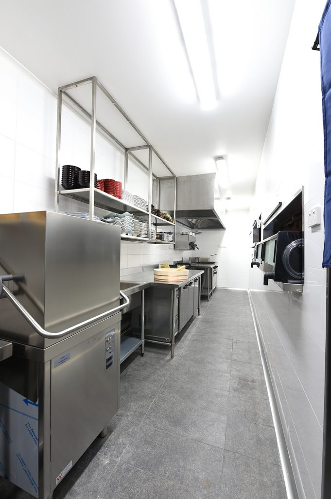 Dishwasher and drying racks in kitchen