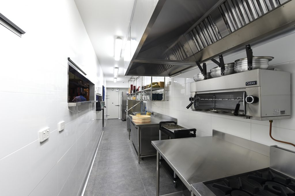Stainless steel grill and bench top in kitchen