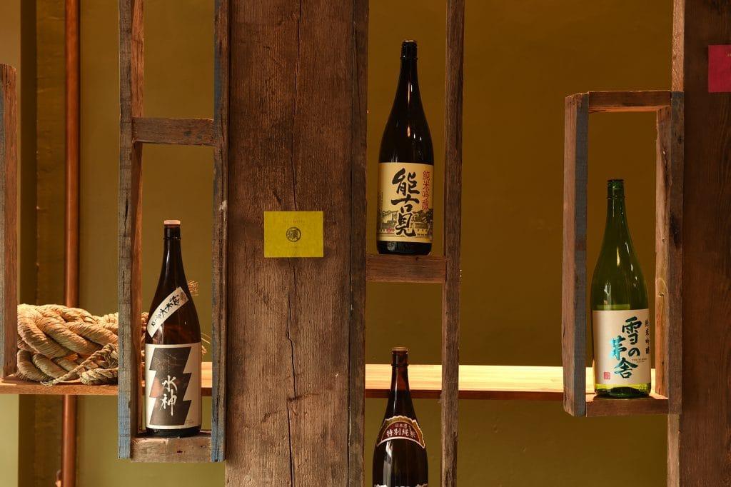 Saki bottles in shelves