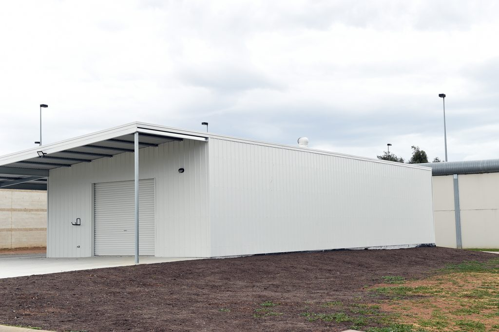 300 square meter warehouse building cladded in white steel