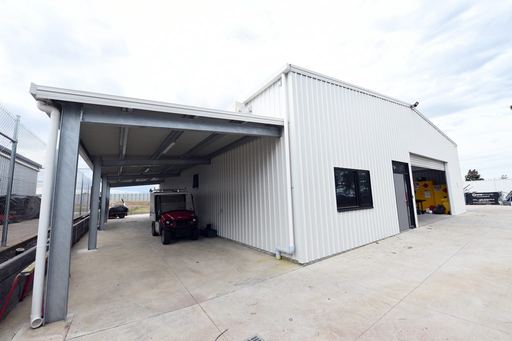 White warehouse building constructed from a structural steel frame cladded in metal sheeting