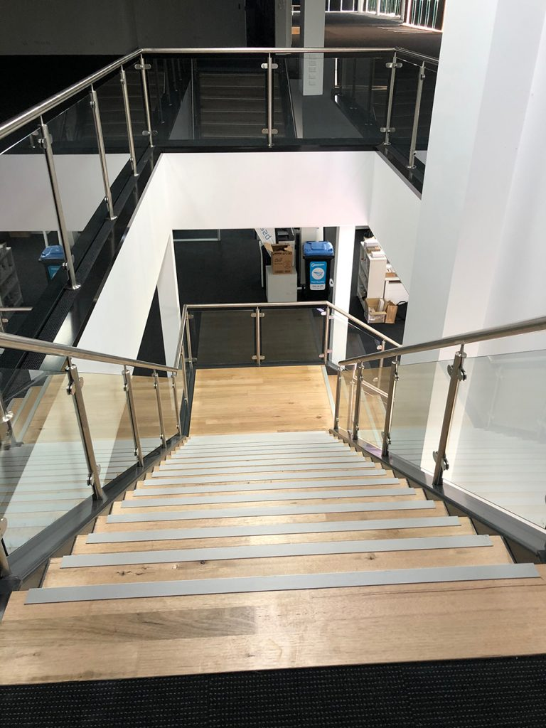Looking down the wood staircase fit-out
