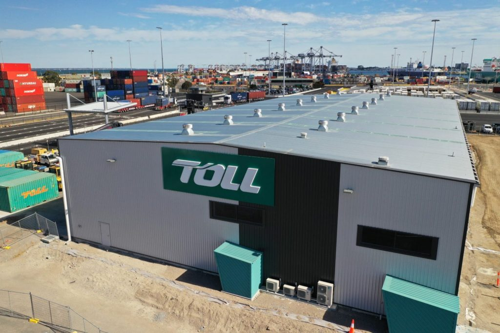 Green TOLL logo marks front of gatehouse 1