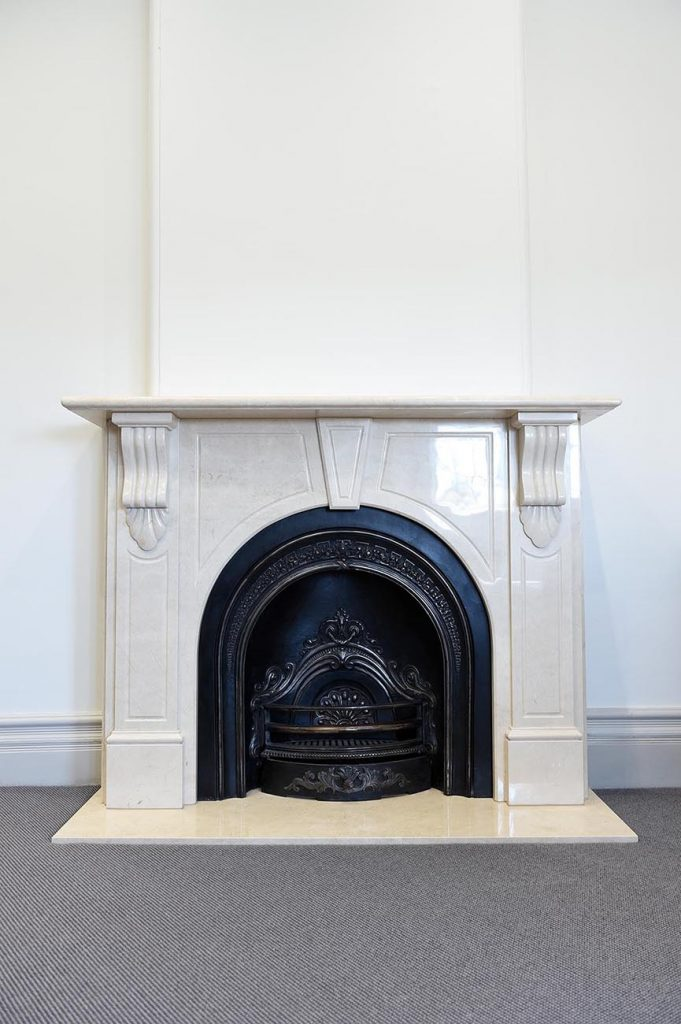heritage fireplace that has been covered with black engraving