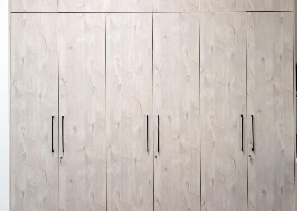 Closeup of marble cupboards with aluminium handles