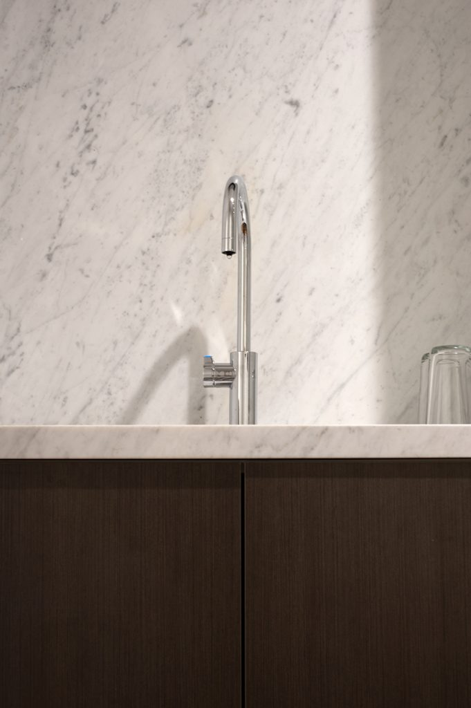 Watson Young Architects kitchen sink in front of marble splash back