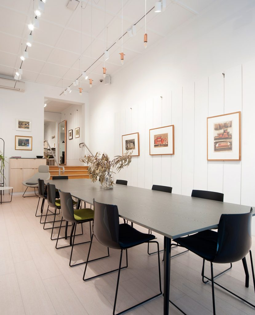 Meeting workspace with down lights and artwork on walls